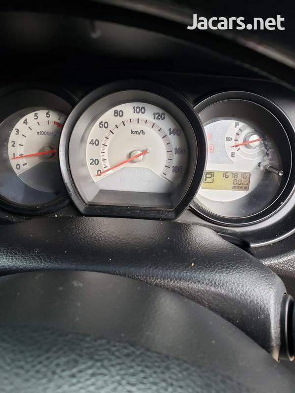 Nissan Tiida 1,8L 2010-6