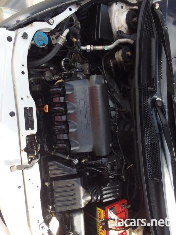 Honda Fit 1,2L 2004-8