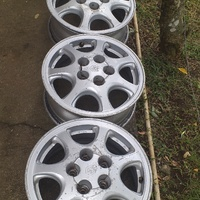 Set of 15 inch Toyota stock rims and one donut.
