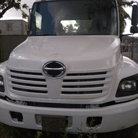 2005 Hino Flatbed and Roll-Off Truck