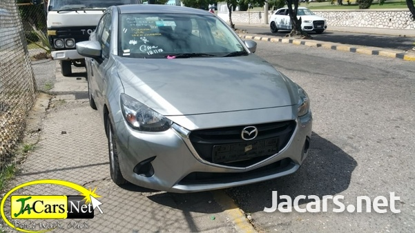 Mazda 323 2016 4