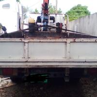 Isuzu Elf. Dropside / Crane Truck