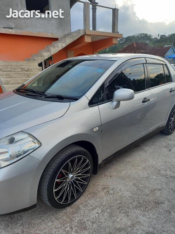 Nissan Tiida 1,8L 2013-6