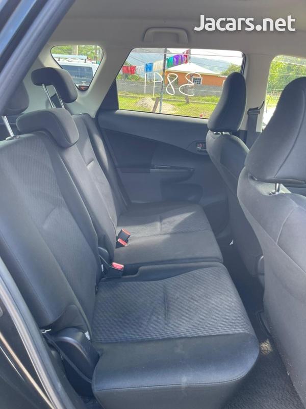 Toyota Ractis 1,5L 2012-7