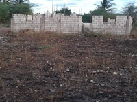1/4 acre of land with a partially constructed 4 bedroom. 8764032330