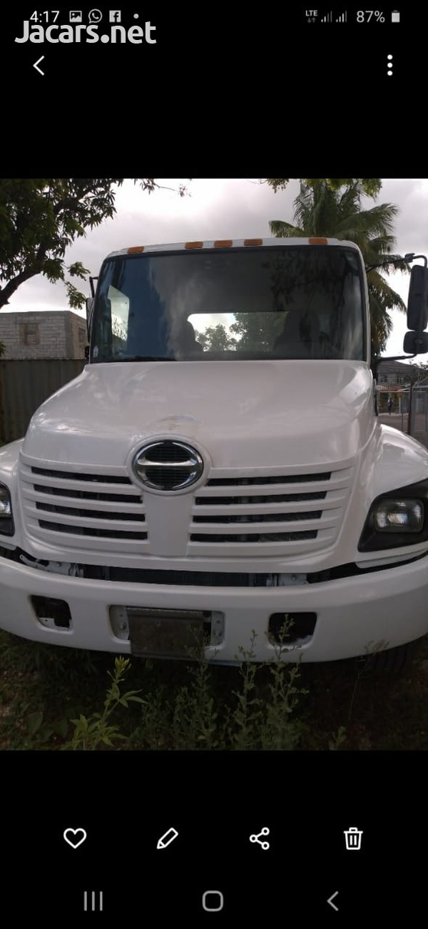 2005 Hino Flatbed and Roll-Off Truck-1