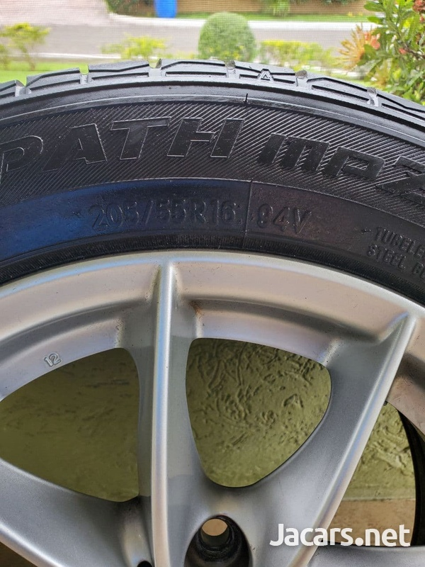 4 Used Original BMW 16 Inch Rims With Tires.-3
