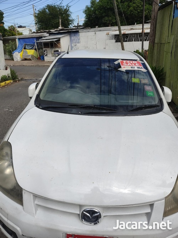 Mazda Familia 1,5L 2011-4