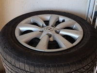 Set of 4 16 inch rims with tyres and hubcaps 215/60 R16