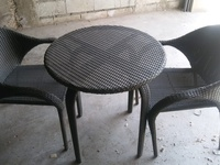 Top quality plastic patio chairs and tables. Three pieces.