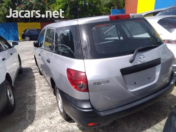 Mazda Familia 1,5L 2014-7