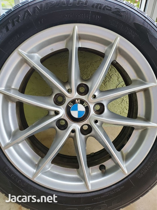 4 Used Original BMW 16 Inch Rims With Tires.-4