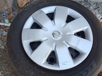 four 15 inch steel rims with tyre an hub cap