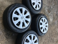 Toyota 15 inch steel rims with original hub caps, fairly new tyres