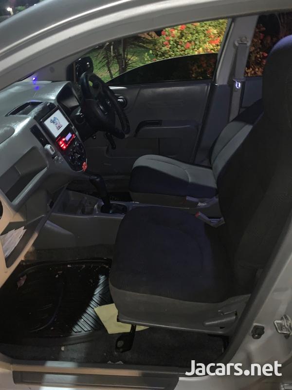 Mazda Familia 1,5L 2011-7